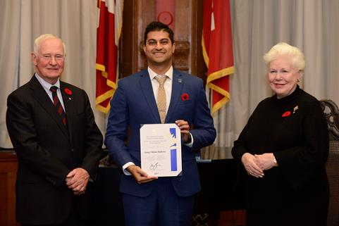 His Excellency the Right Honourable David Johnston, Governor General of Canada (left), along with Her Honour the Honourable Elizabeth Dowdeswell, Lieutenant Governor of Ontario (right), presented the Governor General's Caring Canadian Award to Dr. Sunny Vikrum Malhotra on Tuesday, November 10, 2015, during a ceremony at the Lieutenant Governor's Suite at Queen's Park, Toronto.