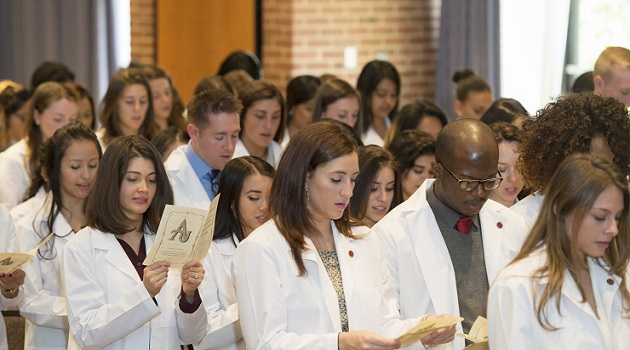 Adelphi University nursing students take an oath to carry out the responsibilities of the profession and provide the highest quality of care to patients and their families.