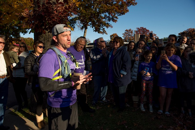"""ay Asparro speaks to friends, family, fans and supporters at the finish line in front of his family parish, St. Pius X R.C. Church in Plainview, after completing his three-day, 90-mile Multi-Marathon Inaugural """"Ann Asparro Run"""" to honor his grandmother and raise Alzheimer's Awareness as well as funds for Long Island Alzheimer's Foundation to make a difference in the lives of others suffering from this disease or other memory disorders. Photo credit: Rob Loud."""